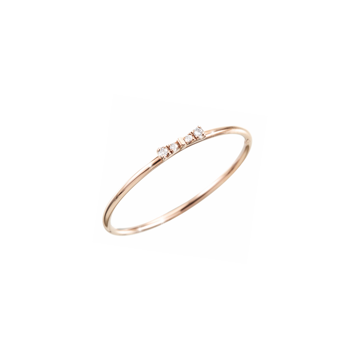 'Less is more' was the motto when Oliver Heemeyer created this mini bow ring.  Reduced design adorned with 4 shiny diamonds handcrafted and made of 18k rose gold.