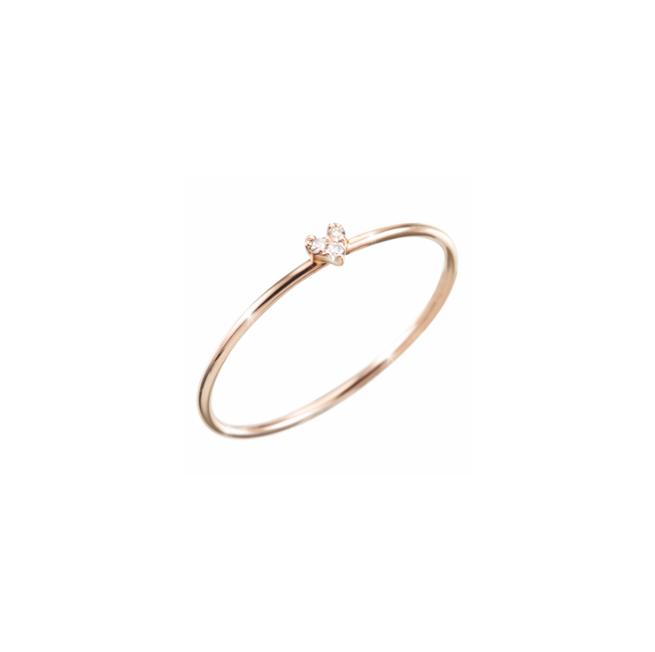 Light, subtle and refined with diamonds. This Oliver Heemeyer ring is made of 18k rose gold and carries three diamonds in the shape of a heart.