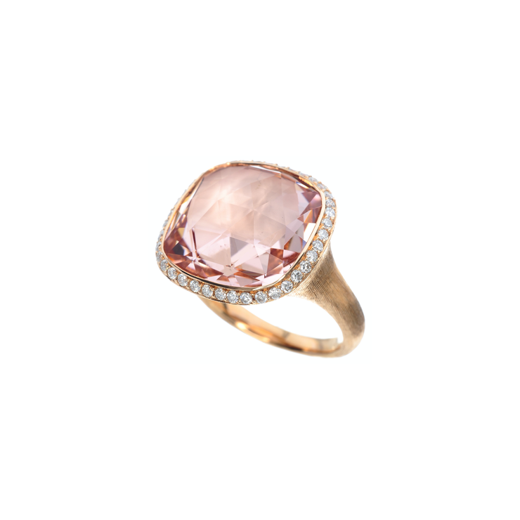 Oliver Heemeyer cocktail ring made of 18k rose gold featuring a stunning morganite in its center. Adorned with diamonds it is a sparkling companion for nights out.