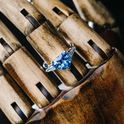 Oliver Heemeyer Ocean Heart Blue Sapphire Diamond Ring on wooden hand.