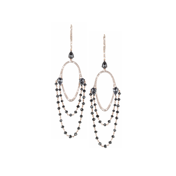 Crafted in 18k rose gold and adorned with 33 black diamonds accompanied by numerous diamonds the black chandelier earrings are a Oliver Heemeyer masterpiece.