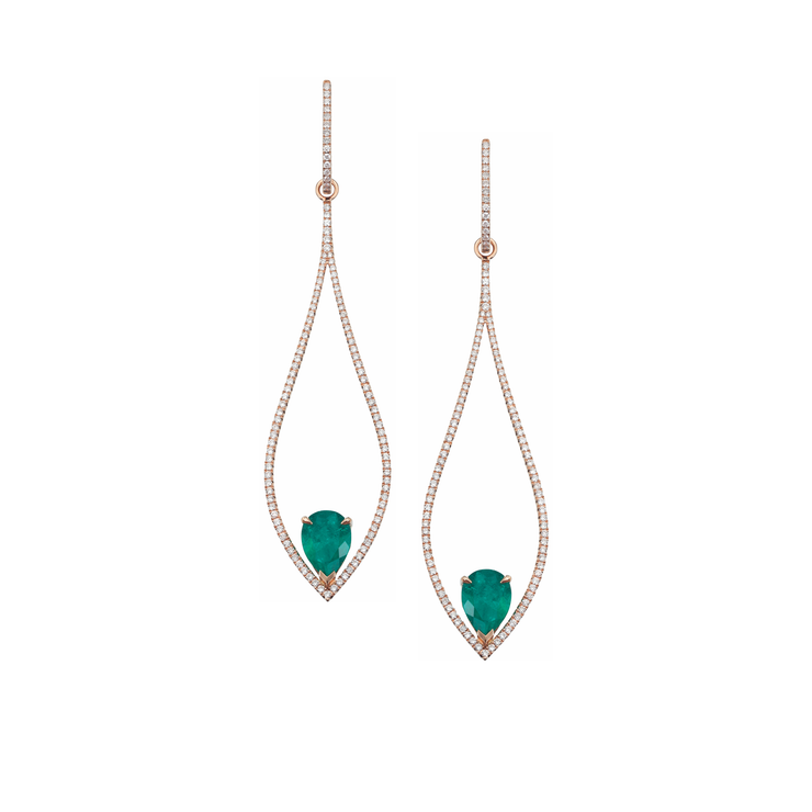 The Oliver Heemeyer 18k rose gold chandelier earrings are adorned with numerous diamonds and refined with two drop shaped Colombian emeralds.