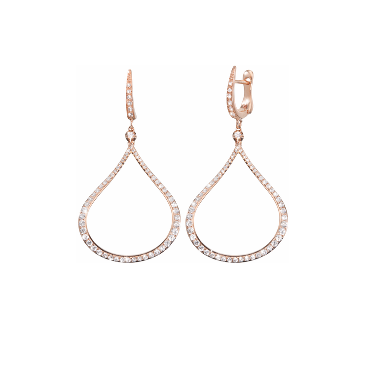 The Oliver Heemeyer Splash earrings are made of 18k rose gold. Set with diamonds, finished off with a single diamond on its top and dangling on a golden u-shape mini hoop.