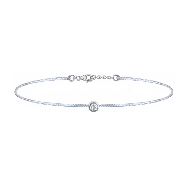Oliver Heemeyer Solitaire diamond charm bracelet crafted in 18k white gold carrying a solitaire diamond. An alluring every day piece of jewellery finished off with an OH pendant. Adjustable length. Colour: Grey.