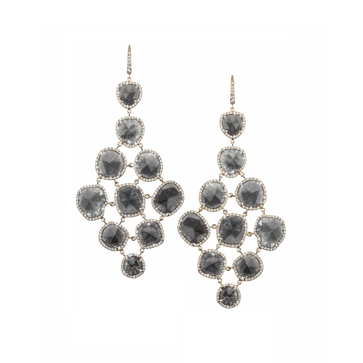 The Oliver Heemeyer Grace diamond earrings are a stunning and unique masterpiece within the Signature Collection. Made of 18k white gold and characterised by extraordinary black Matrix diamonds. This highly sophisticated piece is framed by white and silver gray diamonds.