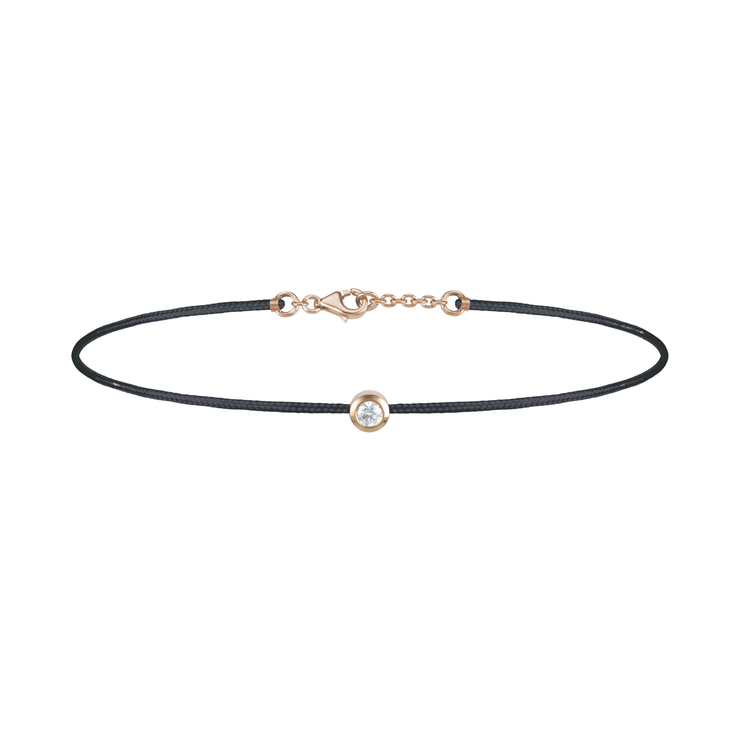 Oliver Heemeyer Solitaire diamond charm bracelet crafted in 18k rose gold carrying a solitaire diamond. An alluring every day piece of jewellery finished off with an OH pendant. Adjustable length. Colour: Black.