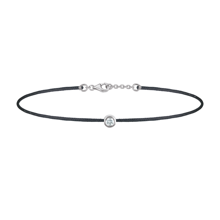 Oliver Heemeyer Solitaire diamond charm bracelet crafted in 18k white gold carrying a solitaire diamond. An alluring every day piece of jewellery finished off with an OH pendant. Adjustable length. Colour: Black.