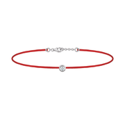 Oliver Heemeyer Solitaire diamond charm bracelet crafted in 18k white gold carrying a solitaire diamond. An alluring every day piece of jewellery finished off with an OH pendant. Adjustable length. Colour: Red.