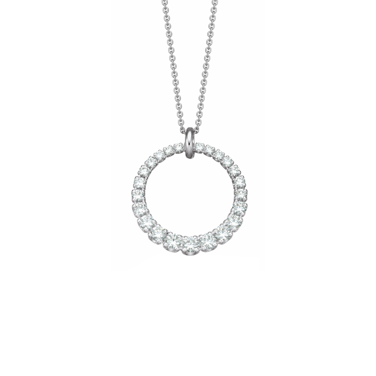 This 18k white gold necklace from Oliver Heemeyer carries a glamorous ring pendant. Adorned with sparkling diamonds various sizes arranged in a fabulous and shimmering ring shape.