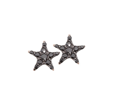 Set with black sparkling diamonds and made out of 18k rose gold. The Oliver Heemeyer star diamond ear studs perfectly go with every outfit and occasion.