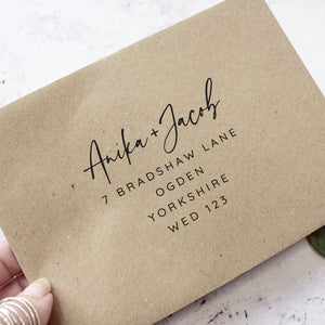 Rustic Kraft wedding envelopes printed with guest names and addresses
