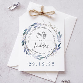 Winter wedding Save the Date cards featuring winter florals