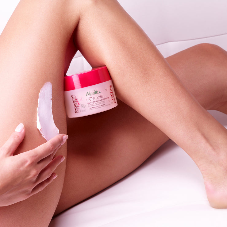 Firming Oil-In-Balm application on thigh area