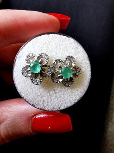 Emeralds and silver earrings. - Kate Diaz