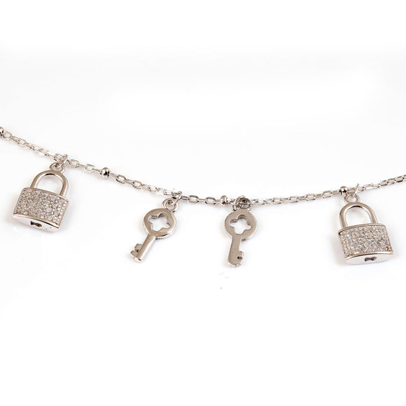 Sterling silver lock and key charm bracelet