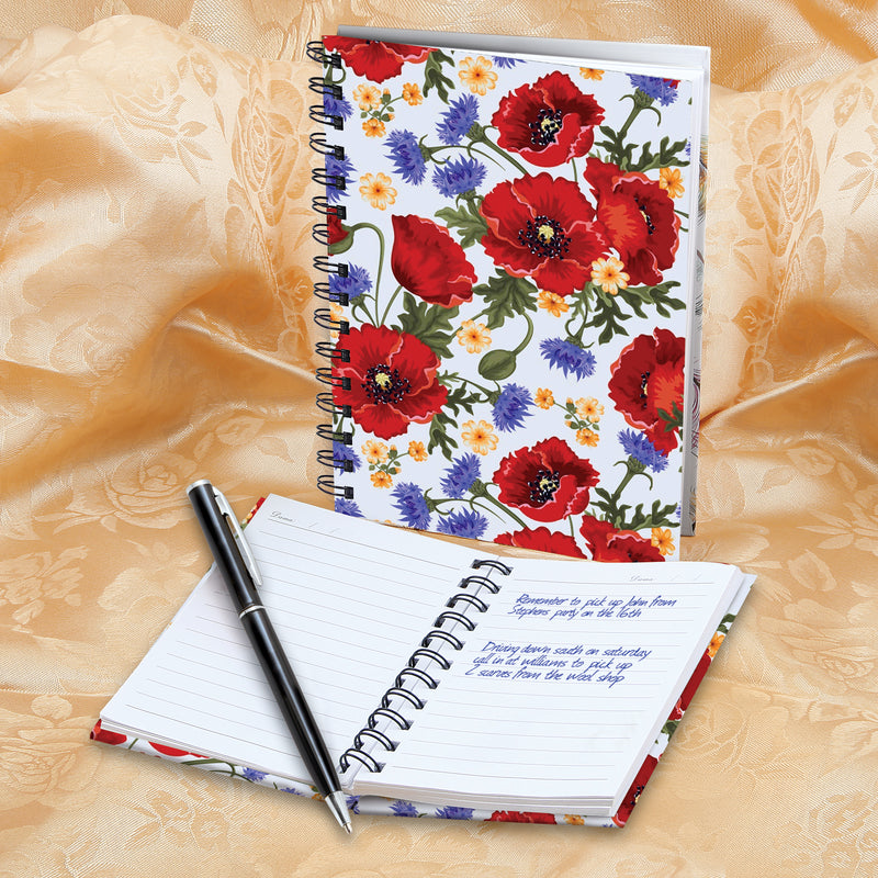 2 HARDBACK POPPY-DESIGNED NOTEBOOKS AND PEN SET