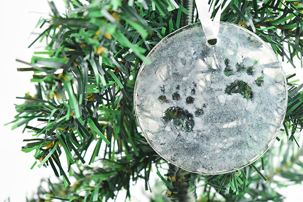 Paw prints in snow fused glass ornament (12GR2519)