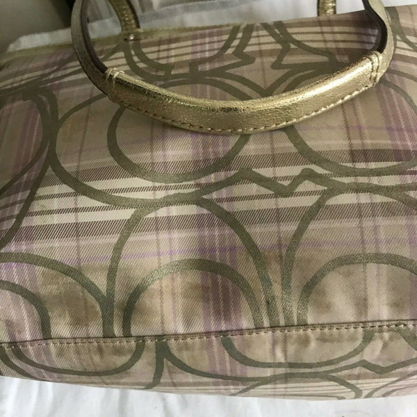 Coach stain fabric khaki tote with multi color logo design