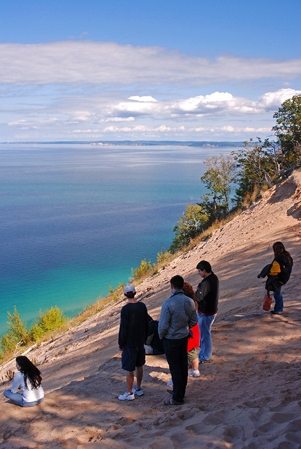Visitors stand atop the Pyramid Point overlook and take in the view of the azure waters