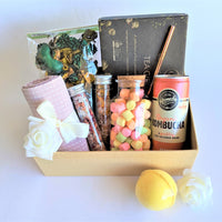 The Swirl Box Pamper gift hamper with tea, tea towel, marshmallows, kombucha, bath salts, bath bomb and potpourri
