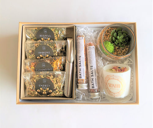 The Swirl Box Bloom gift box with wellness tea gift set, bath salts, candle and faux succulents