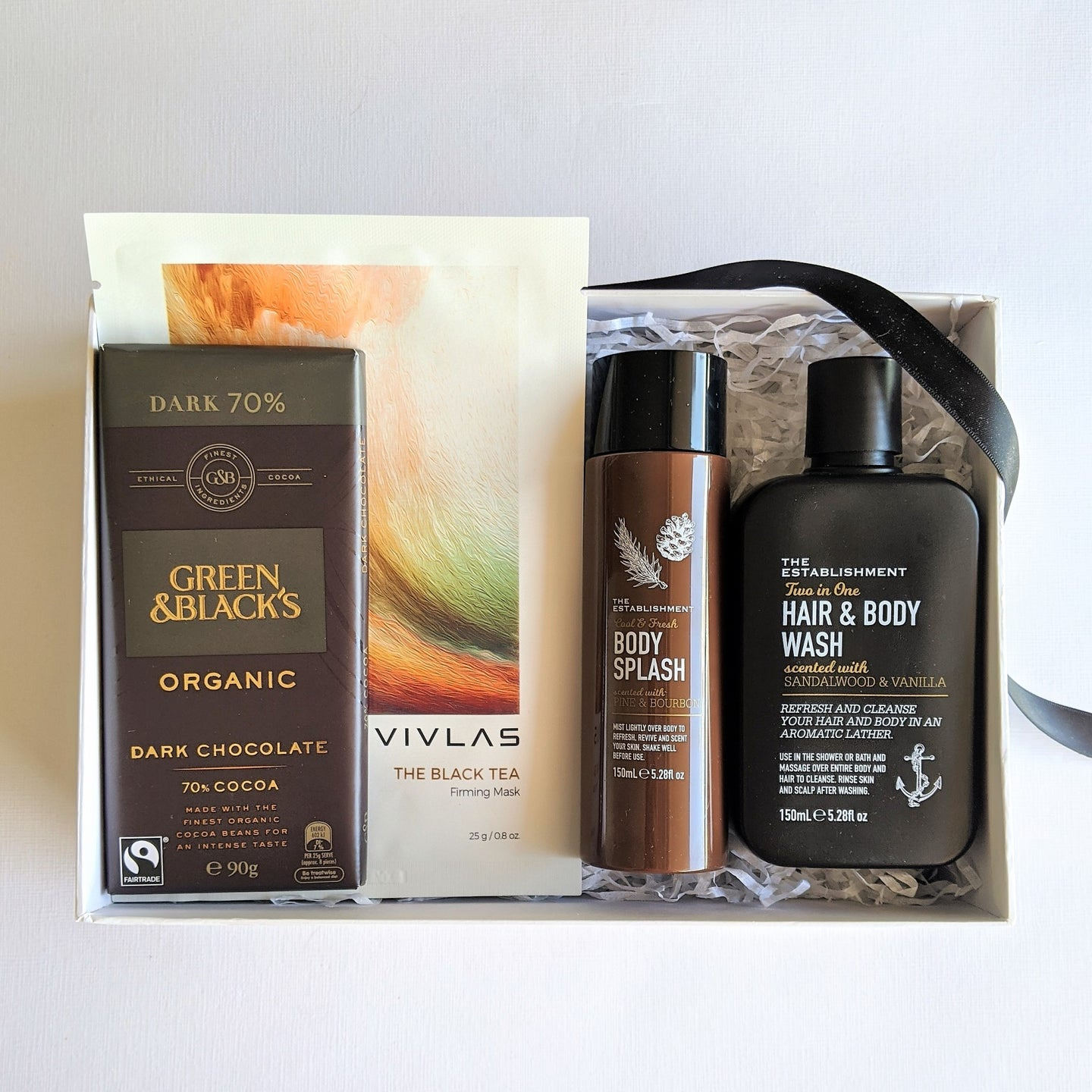 The Swirl Box Fathers day gift for him with organic chocolate, black tea face mask and bath and body products