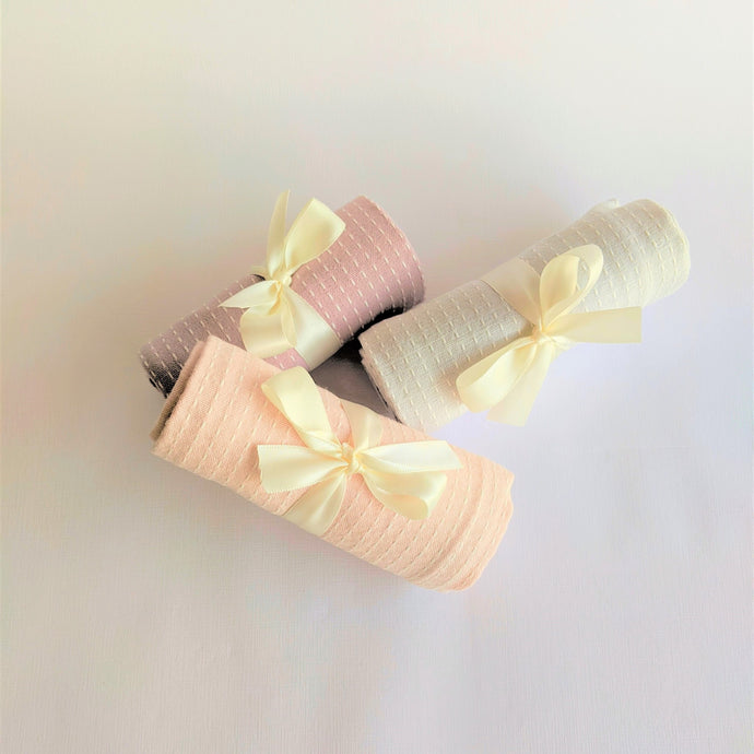 The Swirl Box 3 Tea Towels in pastel shades tied with ribbons