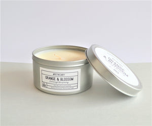 Apothecary Orange & Blossom fragrance soy wax candle in a silver tin with lid, up to 15 hours burning time