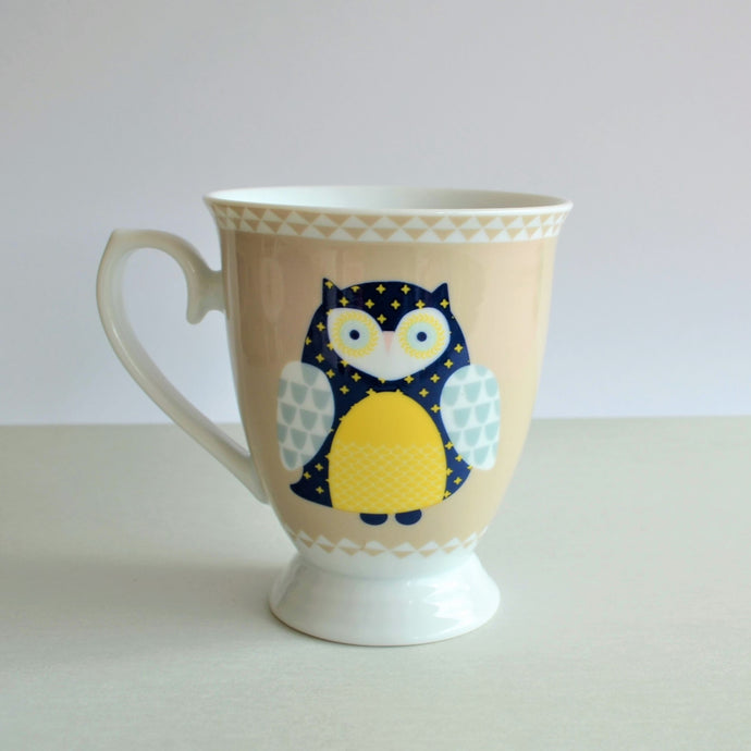 Cream and white footed mug with colourful owl design