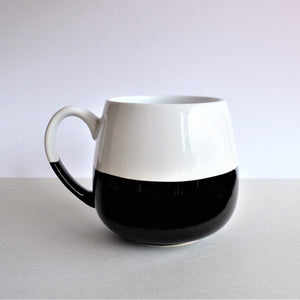 The Swirl Box handcrafted black and white ceramic mug