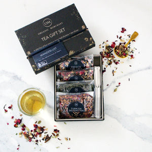 Wanderlust tea gift set with 4 organic and loose leaf teas and infuser