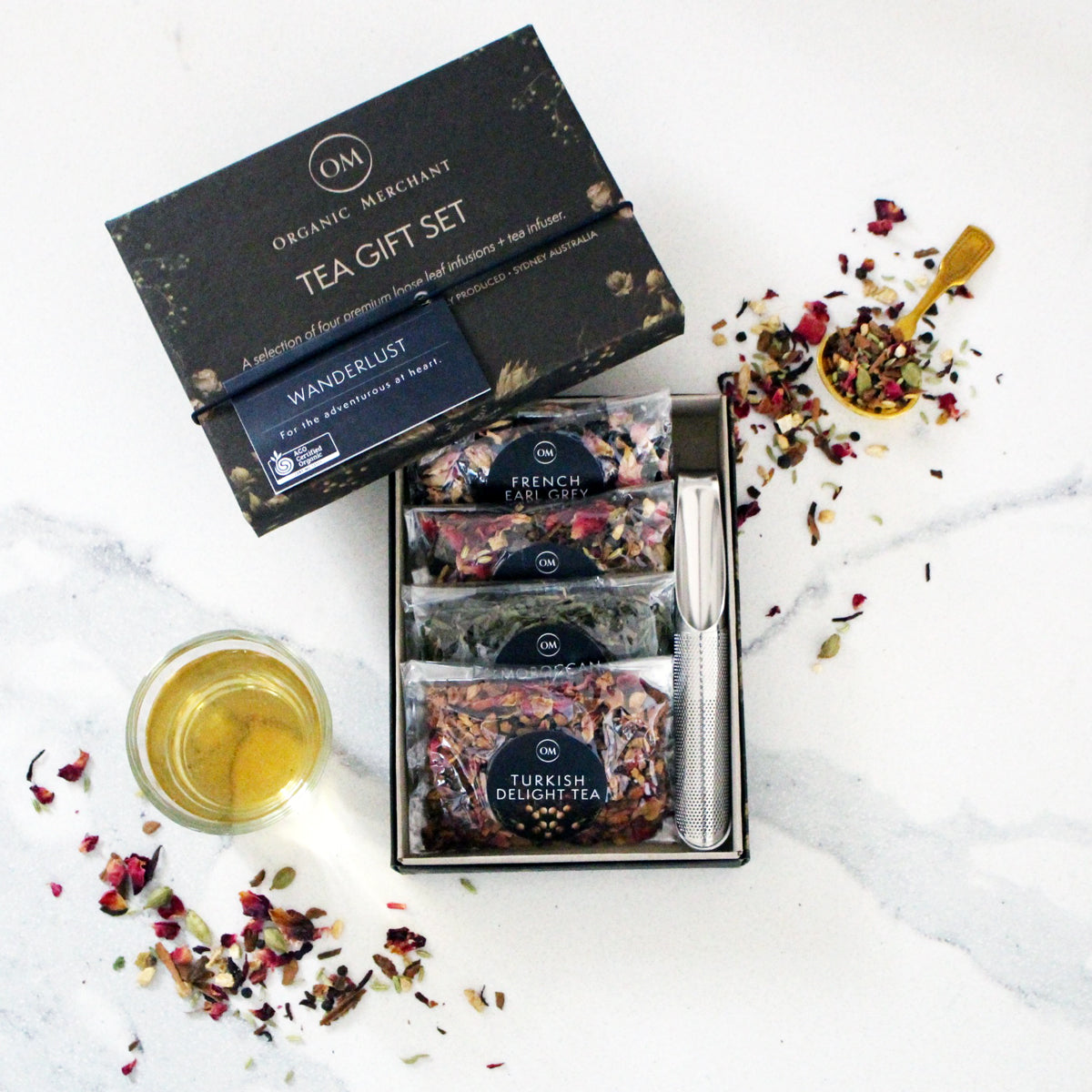 The Swirl Box Wanderlust Tea Gift Set - Loose Leaf and certified organic, comes in a gift box with a tea infuser
