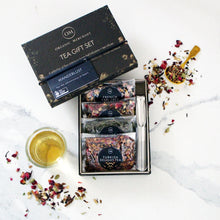 Load image into Gallery viewer, The Swirl Box Wanderlust Tea Gift Set - Loose Leaf and certified organic, comes in a gift box with a tea infuser
