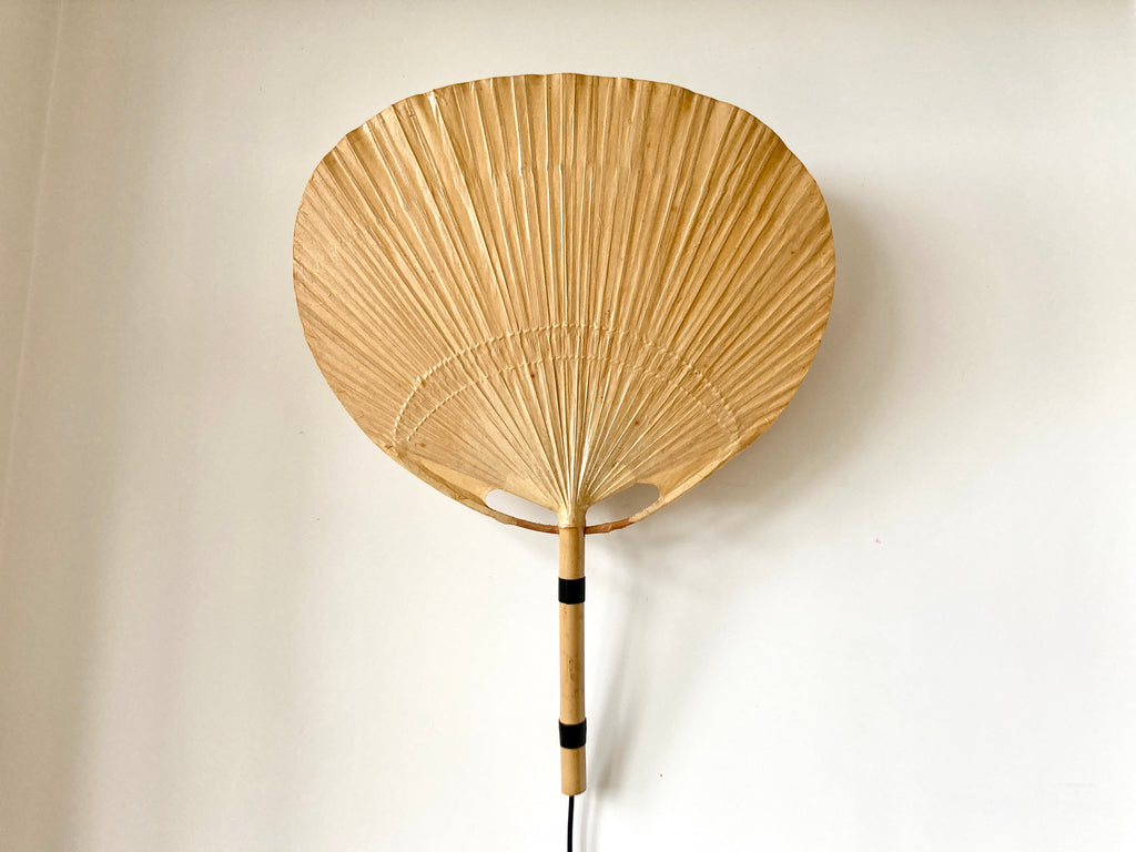Uchiwa fan wall light designed in the 1970s by Ingo Maurer for his Munich based lighting design company, Design M.