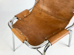 Leather chairs selected by Charlotte Perriand for Les Arcs