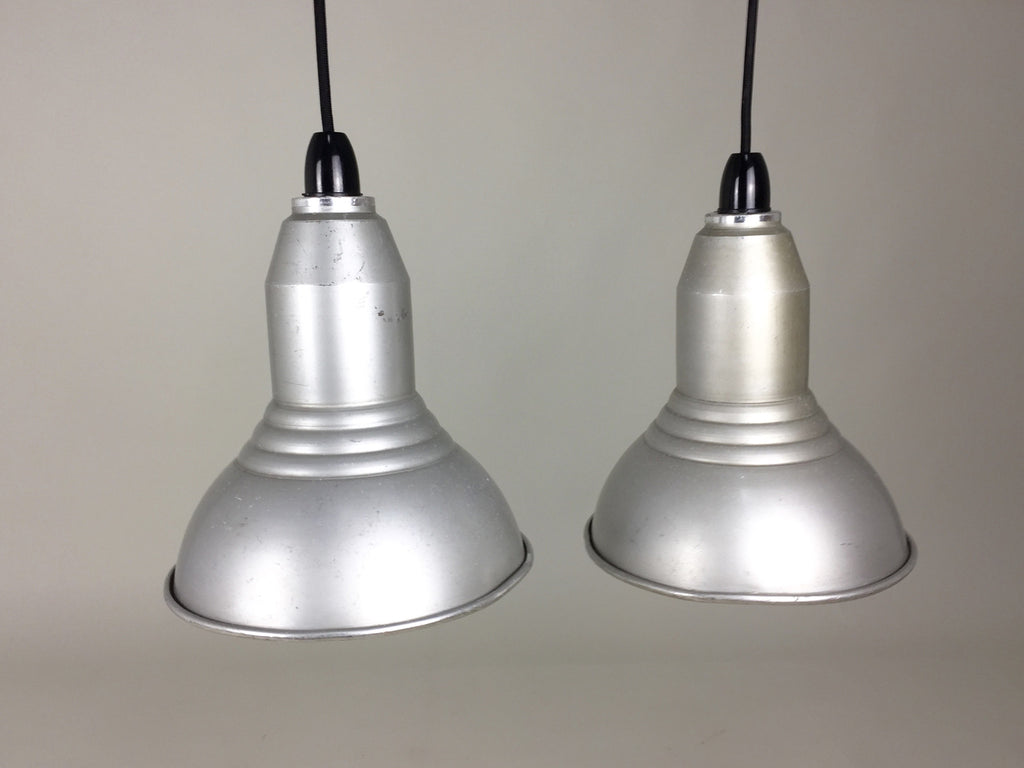 Pair of vintage industrial pendant lights - eyespy