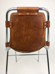 Mid century furniture online: Charlotte Perriand Les Arcs chair tan leather and tubular steel.