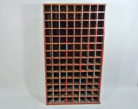 Antique tall pigeon hole cabinet wine rack