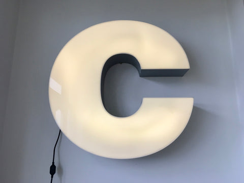 Giant reclaimed illuminated shop sign letter C
