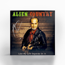 Load image into Gallery viewer, A photo of a CD and it's sleeve. The Sleeve has a picture of Liam Marcus holding an electric guitar. The CD art is a picture of Liam Marcus standing on a scenic  highway with mountains in the background. Scifi country rock