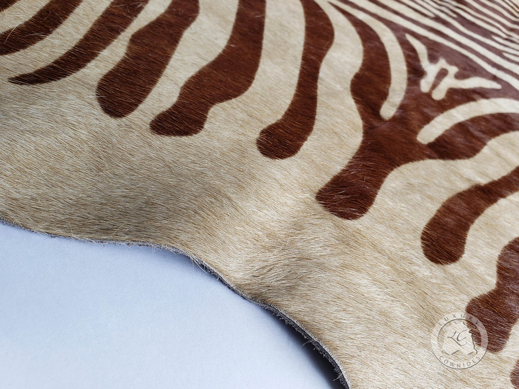 "Zebra Print Mini Cowhide Rug on Beige, Approx. 25"" x 26"""