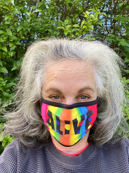 Deborah Kass wearing her ALIVE mask. Photo courtesy of the artist.