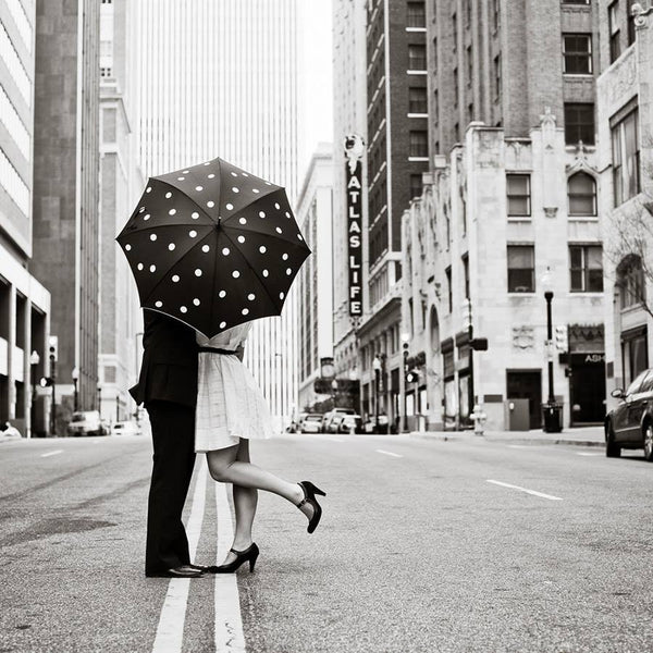 Always carry the umbrella for her. Period.
