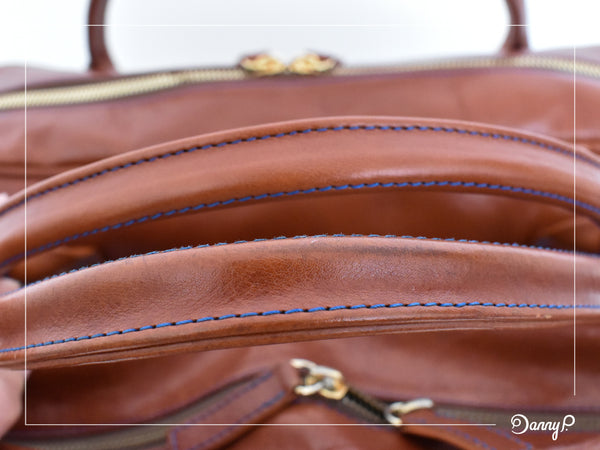 Danny P. leather messenger bag after 4 years of use