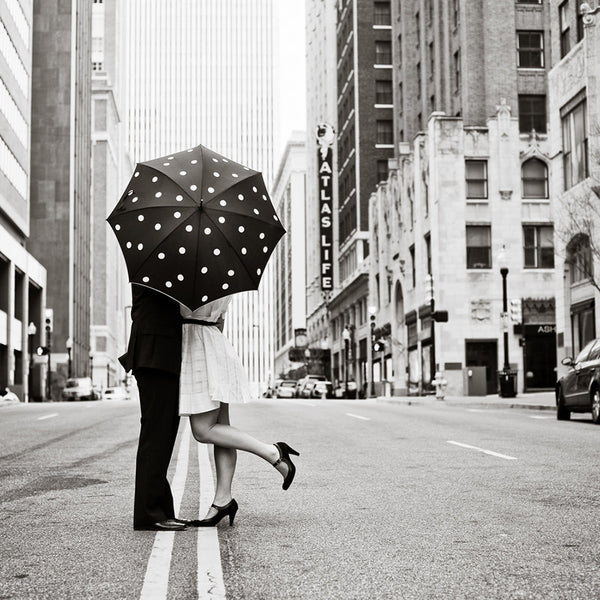 Remember, when accompanying a lady, a gentleman always carries the umbrella for her.