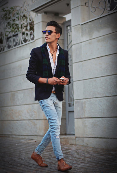 Navy blue blazer with jeans and brown leather shoes