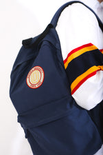 Navy backpack with circular Queens logo