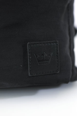 Close up of small crown logo in bottom corner