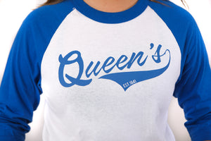 Close up of blue and white baseball style longsleeve with Queen's across the chest
