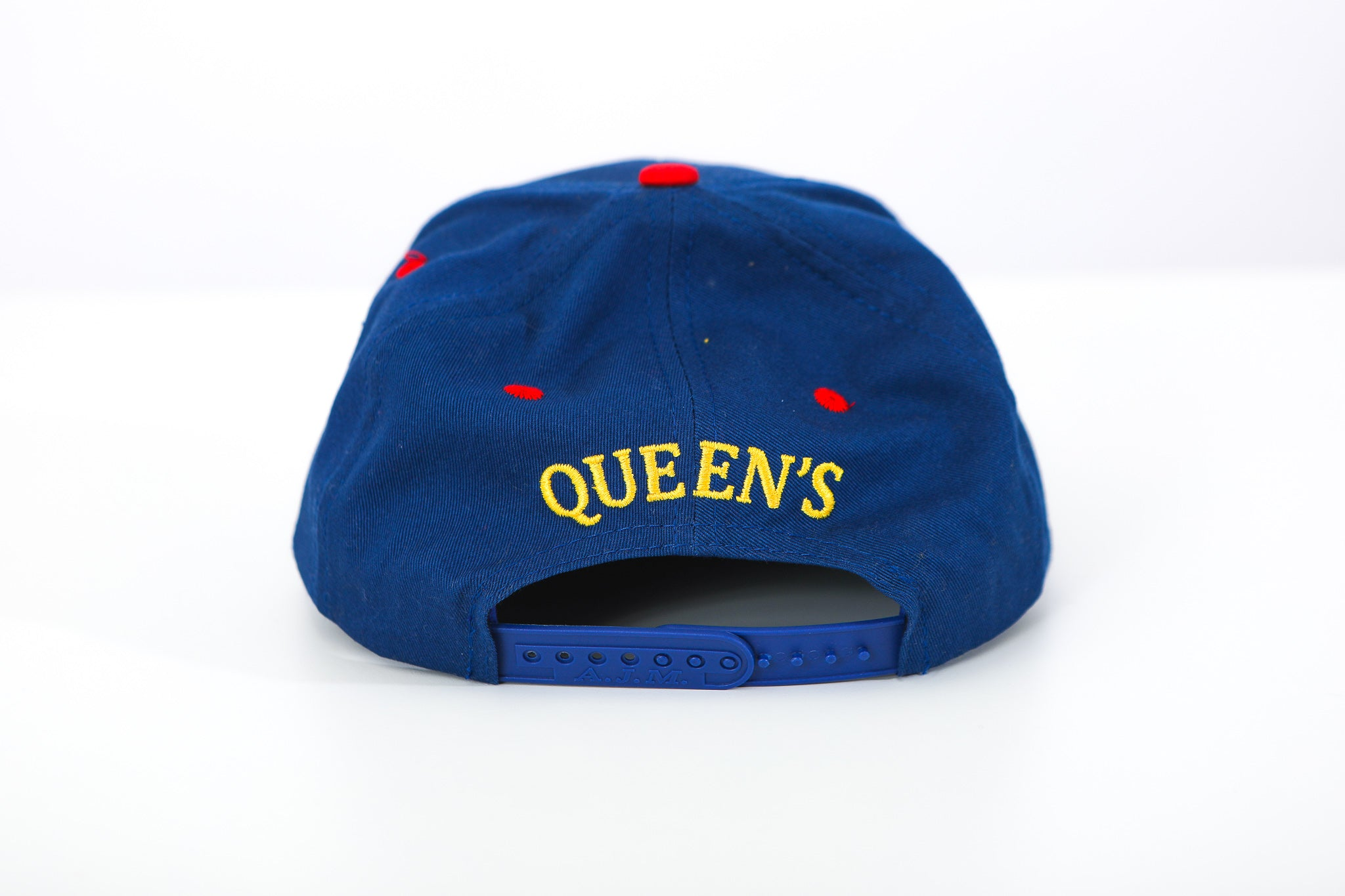 Back of blue snap back with Queen's embroidered in yellow with red details